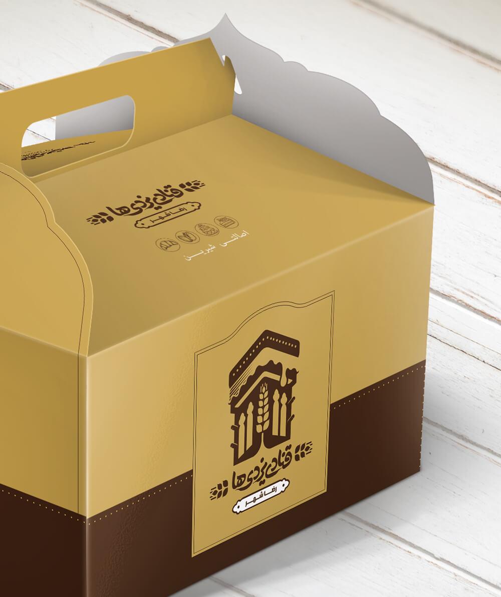 طراحی بسته بندی جعبه کیک قنادی یزدیها